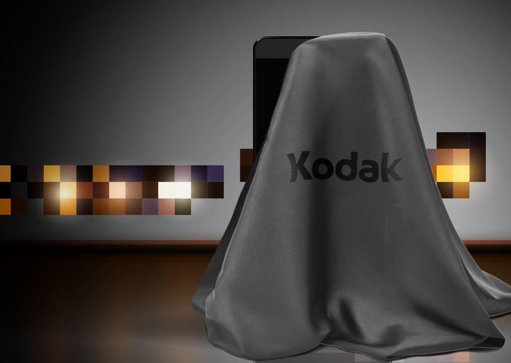 смартфон Kodak под серой тканью